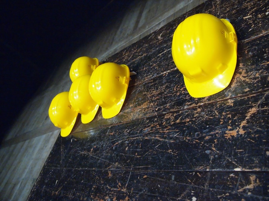 hard hats in preparation for construction procurement opportunities
